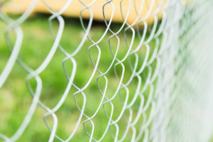 durable construction fence in the country background