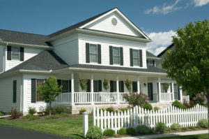 new home with an old country feel. large front porch and the white picket fence for the old time retro look. just one of many new house photos in my gallery.
