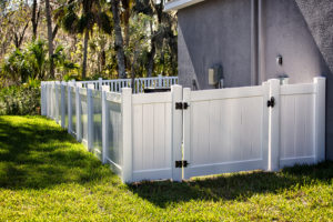 White Solid Privacy Vinyl Fence with gate around house