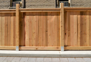 Cedar Fence and paved driveway in urban setting